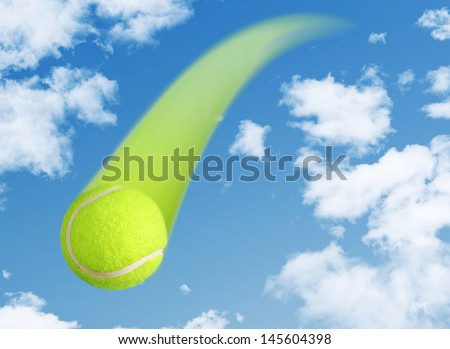Yellow Tennis Ball Flying through a Clear Blue Sky Background - stock photo