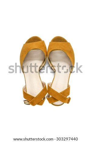 Yellow textile shoes with straps on white background - stock photo