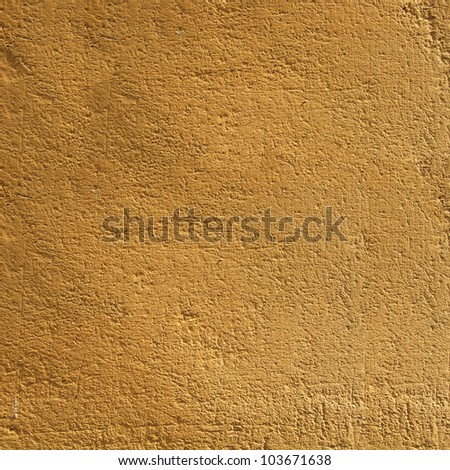 Yellow textured wall Gold colored textured blank wall. - stock photo