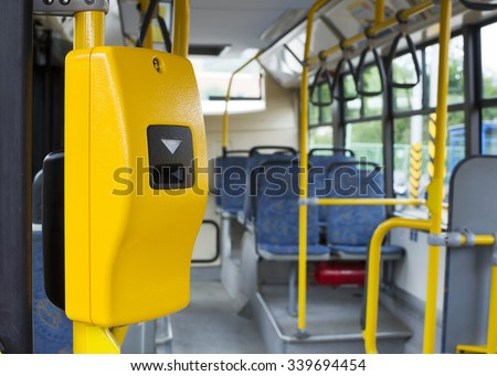 Yellow ticket validation machine on a modern public transport bus