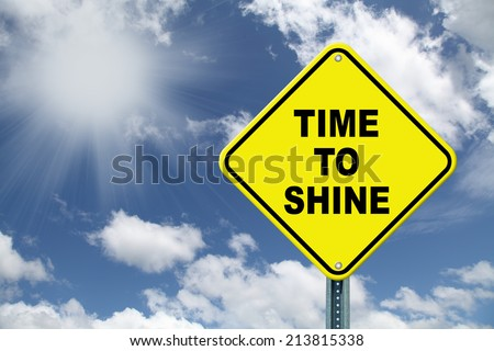 Yellow Time to Shine cautionary road sign - stock photo