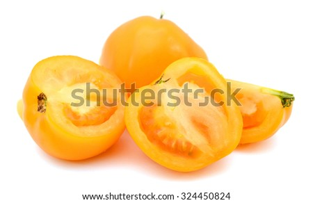 Yellow tomato harvest from a greenhouse, vegetable produce grown by gardeners - stock photo