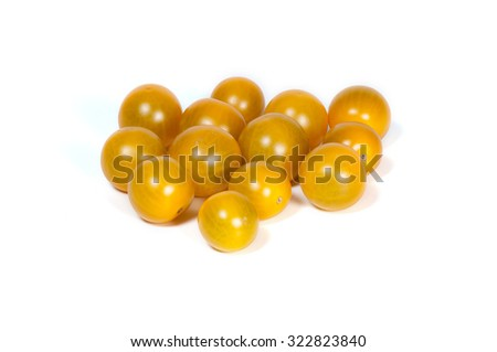 Yellow tomatoes isolated on white background