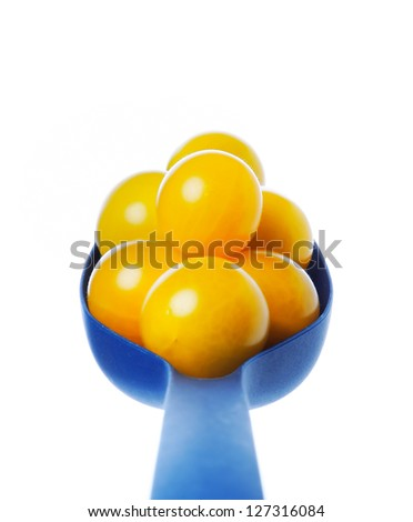 yellow tomatoes on the spoon - stock photo
