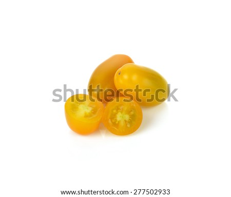 Yellow tomatoes on white background.