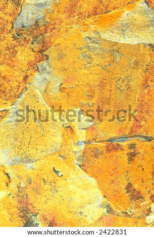 Yellow tonal abstract marble pattern on slate.