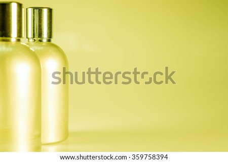 Yellow Tone and Side View : Two aluminum bottles - stock photo