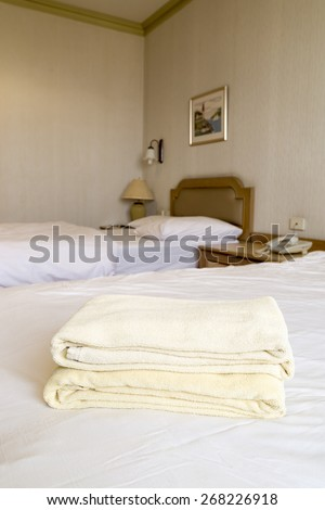 Yellow towels in a hotel room - stock photo