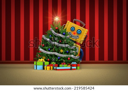 Yellow toy robot standing behind a nicely decorated christmas tree with presents - stock photo