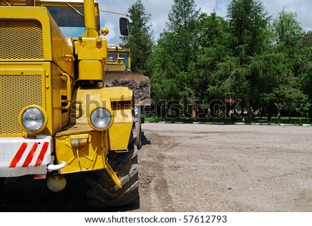 yellow tractor industry truck - stock photo