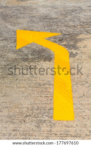 Yellow Traffic arrow on concrete road