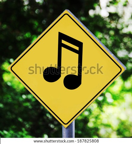 Yellow traffic label with musical note pictogram - stock photo