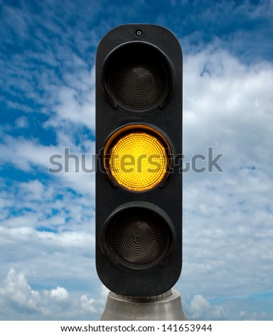 Yellow traffic lights against blue sky backgrounds. Clipping Path included. - stock photo