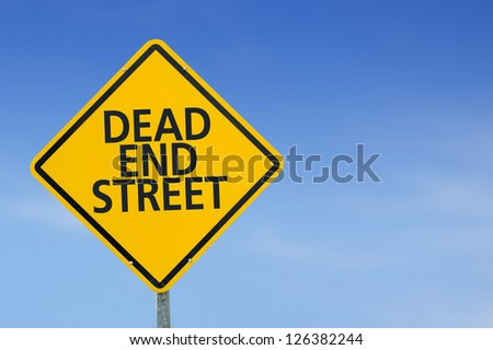 "Yellow traffic sign ""Dead end street"" on the sky background - stock photo"