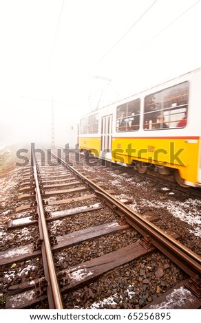 Yellow tram in the fog