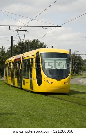 Yellow tramway in Mulhouse, France. Front view - stock photo
