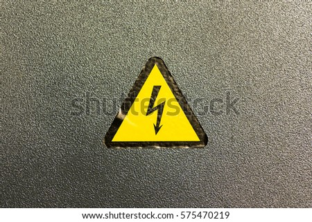 Yellow triangle with black lightning sign. Warning signal about a danger and hazard of high voltage. No entry in the generator area. Free space to enter text.