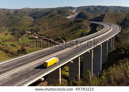 Yellow truck in bridge - stock photo