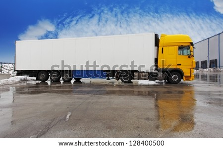 Yellow truck standing  on a parking - stock photo