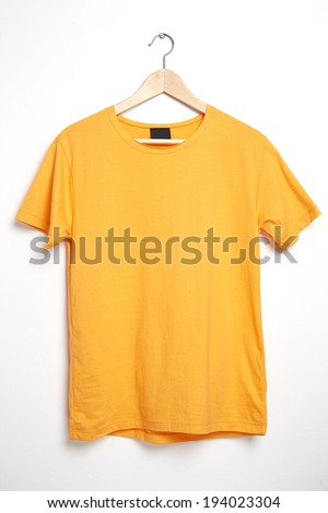 Yellow tshirt template on hanger ready for your own graphics. - stock photo