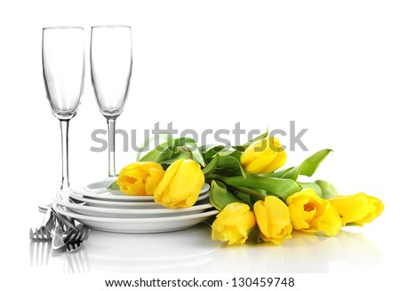 Yellow tulips and utensils for serving isolated on white