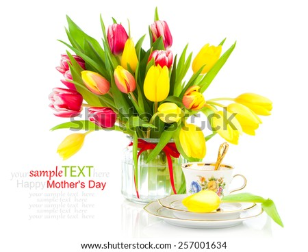 yellow tulips flowers with cup tea, on a white background. breakfast for mommy, happy mothers day, morning drink, romantic still life, fresh flowers - stock photo