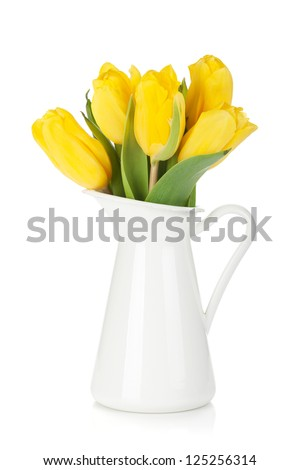 Yellow tulips in a jug. Isolated on white background - stock photo
