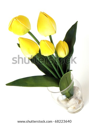 Yellow tulips in a vase for indoor decoration isolated on white background