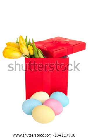 Yellow tulips in festive red box with easter egss - stock photo