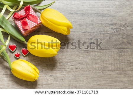 Yellow tulips on wooden boards. Valentine's Day. Women's Day
