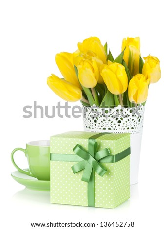Yellow tulips, tea cup and gift box. Isolated on white background - stock photo