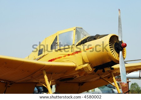 Yellow turboprop airplane on display at museum - stock photo
