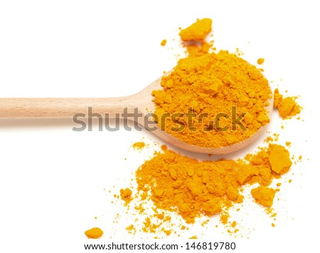yellow turmeric in wooden spoon on white background - stock photo
