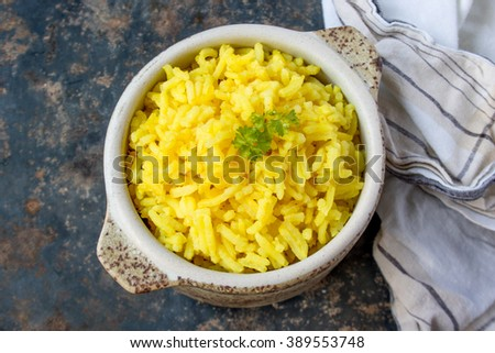 yellow turmeric rice in a bowl  - stock photo