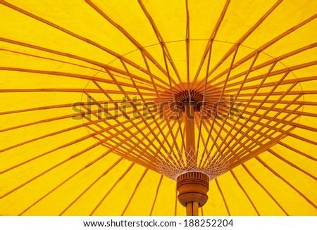 Yellow umbrella  - stock photo