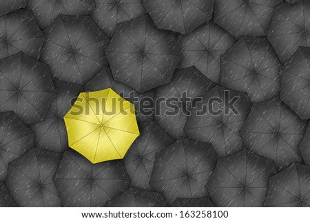 Yellow umbrella. Bright yellow umbrella among set of black umbrellas.  - stock photo