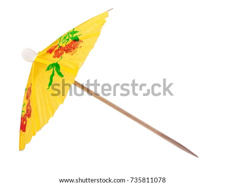 yellow umbrella for a cocktail isolated on white background