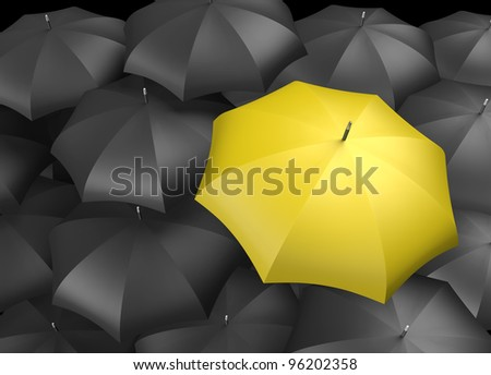 Yellow umbrella standing out from background of black umbrellas - stock photo