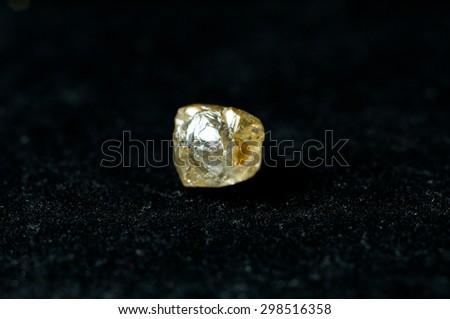yellow uncut diamond - stock photo