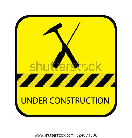 Yellow under construction road sign, with screwdriver, hammer and text under construction - stock photo