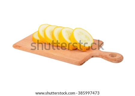 Yellow vegetable marrow (zucchini) on wooden board, isolated on white background