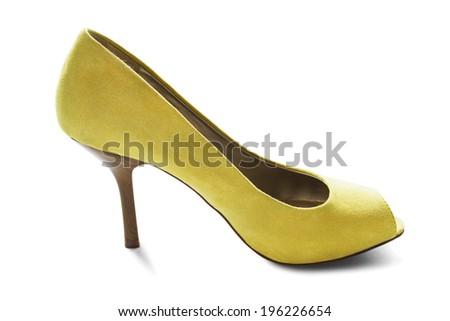 Yellow velvet high heeled shoe isolated over white - stock photo