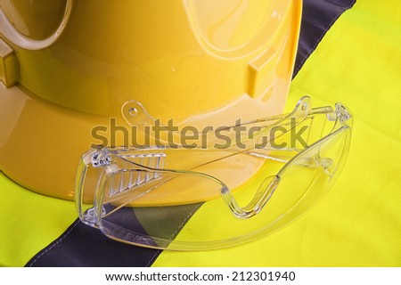Yellow vest and helmet with protection glasses