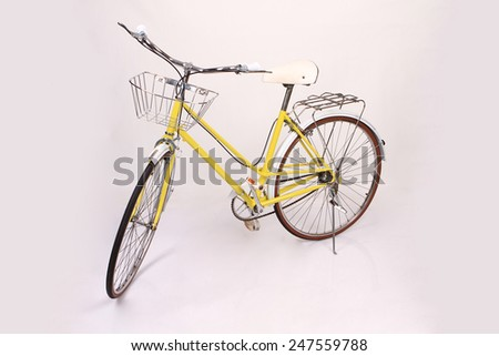 Yellow vintage bicycle - stock photo