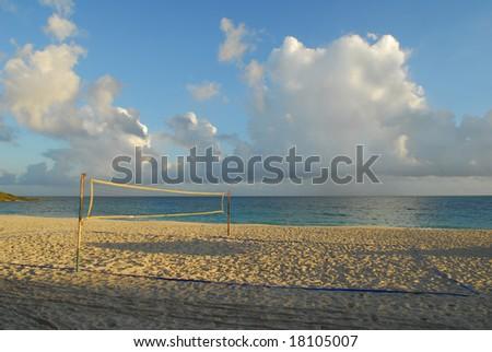 Yellow volleyball net on sunny beach, Cuba - stock photo