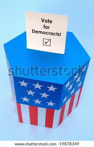 Yellow voting card with Vote for Democracts slogan half-inserted into ballot box decorated with american flag star and stripe colors over blue background - stock photo