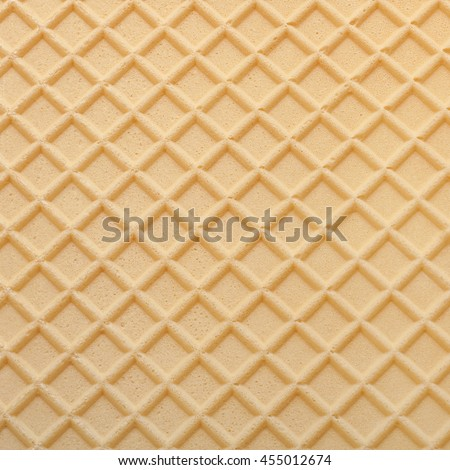 Yellow wafer textured surface closeup background