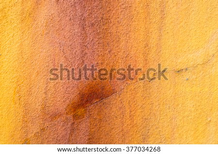 Yellow wall background with sags of rust - stock photo