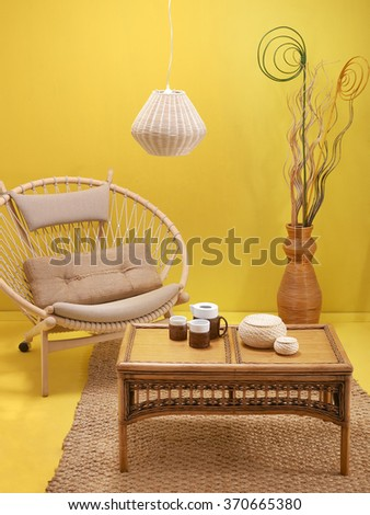 yellow wall interior decoration wicker lighting wicker vase and wicker rug with yellow floor concept - stock photo