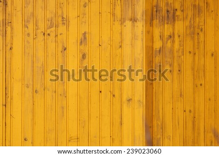 Yellow wall made of wooden boards, background photo texture - stock photo
